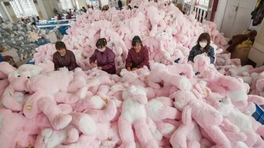Employees manufacture toys at a workshop in Lianyungang, Jiangsu province of China.
